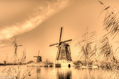 Kinderdijk , South Holland , Netherland (Mike Y. Gyver ( Organize in Albums)) Tags: unesco kinderdijk sky art artwork water windmill weed sepia toned toning warm zen europe exploration emotion randonnée travel yellow imagination infinity outdoor orange paysage peace panorama mygphotographiewixsitecommyg2017 myg mood landscape nikon nikkor18105 hdr history hike goldenhour d90 serenity silhouette quietude walk clouds ciel contrast netherlands