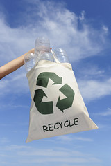 recycling: hand holding bag with plastic bottles (olaialalala) Tags: show sky people woman green nature ecology sign trash bag outside outdoors bottle garbage holding women hand symbol bottles environmental plastic human environment arrow waste recycle recycling showing hold global active reuse recicle reusable utilize
