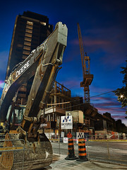 Tear it down, build it up (StephenCaissiePhoto) Tags: road city sunset sky urban toronto tower metal night saturated construction crane stripes dirty signage shovel condos yorkville gloaming