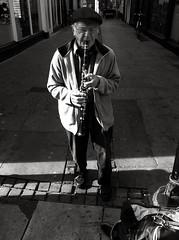 (onelittleeye) Tags: street cambridge shadow portrait people musician white man black contrast person blackwhite shadows unitedkingdom pavement cam grain busker grainy cambridgeshire streetmusician iphone iphone4