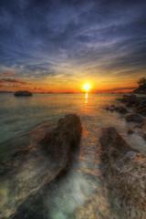 Eye of Boracay (Mabmy) Tags: sunset sea sun canon ball island waves stones philippines sigma 12mm boracay hdr malay 1dx manualblending