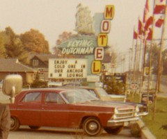 Departing by Bus from the Flying Dutchman Motel, 1971 (Detail) (Alan Mays) Tags: ephemera photographs photos foundphotos colorphotos snapshots buses vehicles transportation bustours charters autos automobiles cars flyingdutchman flyingdutchmanmotel motels anchorroom anchorroomlounge tourists men women clothes clothing canadianflag flags mapleleaf mapleleafflags canada 1971 1970s antique old vintage vptp