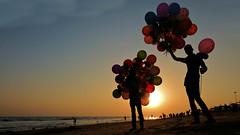 The Balloon Seller Boys at the Beach (pallab seth) Tags: boys kids silhouette balloon odisha puri bayofbengal india sunset playing samsungnx300m samsung16mmf24ifunctionlens orissa 2016