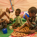A mother gives milk to her children at a UNICEF supported temporary stabilization centre in Waaf Dhuug
