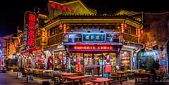 2016 - China - Huangshan - Old Street - 10 of 16 (Ted's photos - Returns Mid May) Tags: 2016 china cropped nikon nikond750 nikonfx tedsphotos vignetting streetscene street nightscene nightlighting seating seats emptyseats neon colourful colorful umbrellas tables benches tunxi ancientstreet ancientstreettunxi tunxiancientstreet oldstreet tunxioldstreet oldstreettunxi huangshan huangshanchina huangshanoldstreet oldstreethuangshan red redrule