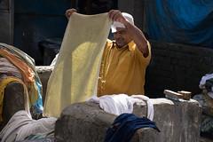 Checking the washing (JohnMawer) Tags: mumbai man towel inspect washing bombay india maharashtra in