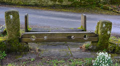 Stocks are St Oswalds Arncliffe (Joan's Pics 2012) Tags: stocks stoswaldschurch sins prisoners old woodenframe putinthestocks