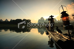 Li river fishermen (MPBHAIBO) Tags: china morning cloud mountain reflection tree water fog stone forest sunrise river landscape outdoors dawn liriver fishing fisherman asia dusk guilin yangshuo hill bamboo cormorant  relaxation  netting cloudscape scenics fishingnet occupation bamboorafting  chineseculture   rainhat urbanscene xingping  ruralscene fishingindustry   karstformation chineseethnicity woodenraft   guangxiregion