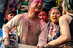 Holi festival, Kathmandu, Nepal (Andrew Taylor Photography) Tags: nepal people music man colour festival women guitar celebration entertainment kathmandu subject colourful festivity holi durbarsquare environmentalportrait happyholi basantapurdurbarsquare colouredpowder shivaparvatitemple playholi