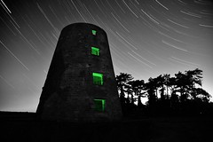 Amityville windmill (explore #79) (Kriegaffe 9) Tags: windows sky green abandoned windmill silhouette night dark stars trails eerie spooky amityville