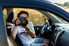 A photographer shooting from the car (Shkurlei) Tags: light summer portrait people man color male nature field grass yellow horizontal closeup 50mm evening nikon photographer riverside adult natural eveningsun bokeh outdoor background picture lifestyle naturallight ukraine headshot professional curly single production backlit 70200 attentive портрет reallife takingpictures zoomlens shallowdof individuals canon1ds d600 midadult casualclothing фотограф realpeople україна singleman фото withacamera simpleliving ivanofrankivsk іванофранківськ lookingthroughthecamera flickraward goldstaraward фотографія shkurlei сімейне