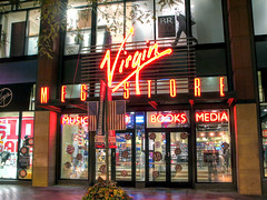 Virgin Megastore (closed) in Denver (*Checco*) Tags: life street door city travel light urban usa money reflection building window shop retail wall architecture modern night facade america mall outdoors lights evening design store twilight streetlight colorado colorful downtown commerce cityscape nightscape symbol market sale contemporary flag citylife front denver structure goods business commercial buy customer headlight brand purchase consumer cityview buying downtowndenver downtowndistrict 16streetmall