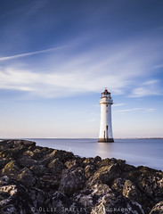 Perch Rock Lighthouse. (Ollie Smalley Photography (OSP)) Tags: ocean old longexposure blue sea portrait sky orange brown lighthouse white black building water yellow contrast canon eos high rocks natural cloudy tide horizon tripod rocky delta landmark historic estuary filter le lee nd getty 5d geography 24mm manual geology fullframe iconic manualfocus ff mersey clearsky gettyimages hightide manfrotto distant wirral newbrighton osp geological 24105mm leadingline manualexposure canon24105mm perchrocklighthouse 5d2 10stopfilter 5dii canon5dmarkii leebigstopper olliesmalleyphotography