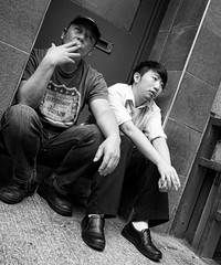 Cigarette break (Damien Sass) Tags: street city nyc two people urban blackandwhite bw newyork men work photography mono chinatown break employment cigarette olympus bigapple omd em1
