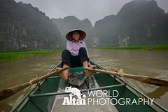 Woman Paddling Boat with Feet (Altai World Photography) Tags: woman feet hat river boat asia rice south north paddle row east vietnam limestone southeast karst tam bing coc ninh tamcoc vnm ninhbing conicalfeet