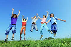 Group of five happy children jumping outdoors. (Dorpskrant Tricht) Tags: blue boy summer sky people green girl up field grass childhood sport horizontal youth children fun outside happy kid spring big team jump jumping friend colorful child play friendship outdoor many five joy group young meadow lifestyle happiness copyspace tween joyful adolescent playful leaping active upward caucasian