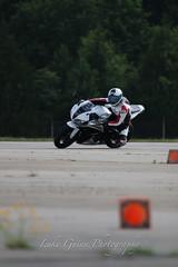 V51A1951 (lgphotoshare) Tags: race speed honda fun outdoor scooter triumph motorcycle sportbike wheelie stunts cbr shoei speedtriple kneedragging 7dmkii ef70200ismkii