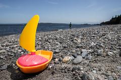 Gone Boating (Mista Sparkle) Tags: vacation beach toy boat rocks plastic tacoma mtrainier gravel pointdefiancepark