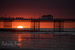 Sunset (sabrinafennphotography) Tags: sunset red sea sky orange sun water silhouette skyline architecture night landscape fire pier nikon outdoor dusk norfolk d750 setting cromer