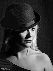 Lady Bowler (trevager) Tags: blonde bowlerhat brightpixphotography colourpop copyrighttrevorager effects elinchrom flash girl hats lighting material modeldonnawest mono posing scc strobes studio fabric