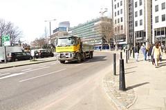 P1100114 (smith.rodney74) Tags: lx65btz metalbollards towercrane scaffolding barebranches londonlandmark ringroad trafficlights yellowtruck