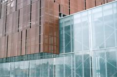 Locking Blocks (Jetcraftsofa) Tags: nikonf3 nikkor502 vista200 35mm filmphotography buildings architecture availablelight forms yinyang