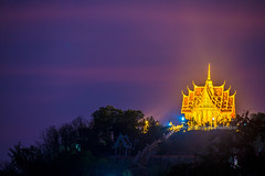 Thai Temple on top of the mountain with colorful sky. (baddoguy) Tags: above art awe beautyinnature buddhism buildingexterior builtstructure chapel church clearsky colorimage copyspace dramaticsky dusk famousplace forest heaven hill horizontal igniting khaoyainationalpark landscape locallandmark majestic mountainpeak multicolored nakhonratchasima nopeople photography placeofworship planetearth religion sky southeastasia templebuilding thaiculture thailand tourism travel traveldestinations twilight unusualangle