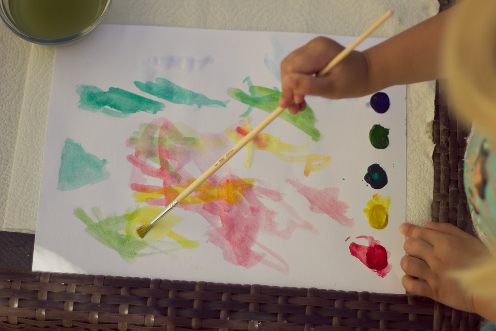 Painting with DIY watercolor pages - crafts for kids while camping