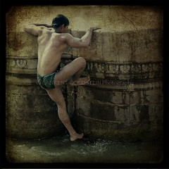 Bathing in the Fountain of Youth (designldg) Tags: light people india man male heritage texture water mystery composition sunrise river square photography dawn bath asia colours skin artistic body muscular pillar dream culture atmosphere human soul ethereal devotion varanasi strength spiritual shanti dharma salvation kashi oldcity timeless ganga ganges ghats banaras benares benaras uttarpradesh  corporeal banarsi scindiaghat indiasong sacredrivers corporeality langot theoldestlivingcityintheworld panasonicdmcfz200 laurentgoldstein