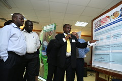 Day 1: Participant presents during the poster session (International Livestock Research Institute) Tags: uganda kampala ilri valuechains crp2 crp37 agrifoodchain