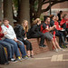 Students sit in front of Harrelson Hall to watch the wrestling practice.