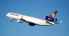 Lufthansa Cargo McDonnell Douglas MD-11F D-ALCB Climb (Mark 1991) Tags: man manchester lufthansa md11 manchesterairport mcdonnelldouglas lufthansacargo dalcb