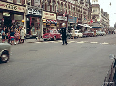 Essex Town - Mid 1960's... (colinfpickett) Tags: road street cars crossing memories streetscene shops policeman daysgone