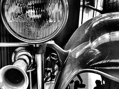 Tilt Ray Headlamp (derek.dpr) Tags: brussels bw black glass monochrome car ray olympus chrome headlamp horn tilt omd chromium autoworld em5