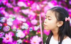 Asian little girl is blowing a soap bubbles (anekphoto) Tags: park light summer portrait sun game flower cute green nature girl beautiful face grass childhood smiling yellow female season asian fun outdoors happy person kid spring soap healthy funny pretty child play little joy innocent daughter young meadow happiness bubbles blowing blow human thai leisure positive lovely sunbeam cosmos caucasian