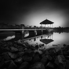 ... test of time ... (Jazpar) Tags: longexposure monochrome dark pier blackwhite singapore rocks jetty vision le minimalism lowkey minimalist waterscapes testoftime
