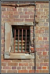 Barred Window (Rubio-Martinez) Tags: windows abandoned metal bars iron fuji steel bricks rusty albany disused x100 greatsouthern fujifilmx100