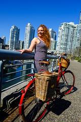 Mia Kohout (Bhlubarber) Tags: city portrait urban woman bike bicycle vancouver photography cyclist stripes seawall 14mmf28 yaletown redhair westender stepthrough davidniddrie wevancouver miakohout momentummag vivajuliett fujixe1