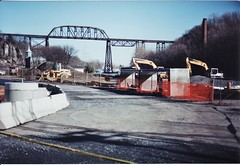 WILBUR ON RONDOUT IN 1998 (richie 59) Tags: street city trestle bridge trees winter urban usa streets film water america creek 35mm outside us parkinglot waterfront unitedstates bridges historic kingston smokestack 35mmfilm 1998 newyorkstate oldpictures filmcamera constructionsite 213 backhoe oldpicture 1990s olddays wilbur nystate hudsonvalley citystreet kingstonny historicbuildings streetwork railroadtrestle ulstercounty traintrestle smallcity twolane 2lane midhudsonvalley americancity jan1998 ulstercountyny rondoutcreek oldsmokestack westshorerailroad rt213 route213 picturescan oldtrestle richie59 wilburny 35mmpictures old35mmpictures jan111998