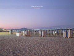 The end of the summer (Carlos Ciudad - Stock Photography) Tags: trip travel sunset summer vacation sky espaa beach valencia colors night clouds canon relax awning atardecer lights luces noche twilight spain sand holidays europa europe chairs cleanup nobody playa colores sierra arena deck viajes cielo nubes verano end bluehour fin turismo economy vacaciones ocaso crisis economia gettyimages descanso montaas montains castellon turistas turism nadie peiscola tranquilidad sunshades turist guardar toldos tumbonas putaway playanorte recoger s95 serrademontsi costadelazahar horaazul gettyimagesspain cctrillastock