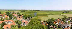 Waterland is a protected rural landscape of open fields and small villages (Bn) Tags: blue summer sky lake holland green tower church water grass amsterdam rural high topf50 village north canals wetlands vista grassland polder viewpoi