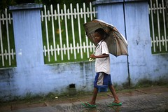 A boy in the rain (N A Y E E M) Tags: street boy rain umbrella candid fullframe tilt bangladesh carwindow chittagong navalavenue