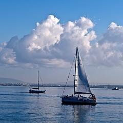 Sailing at the end of the day (pedrosimoes7) Tags: leica blue portugal wow river peace lisboa lisbon atmosphere creativecommons tagus tagusriver riotejo leicam leicam9 goldenart vividstriking terreirodopaco leicam9p wowl2