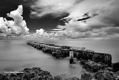 """On the Edge"" (Javier Huanay) Tags: sea bw nature clouds pier nikon key rocks long exposure florida negro 400 nubes nd siesta sarasota d800 2470"