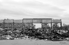 (absolutelyultimate) Tags: sky clouds canon rebel blackwhite detroit t3 remains rubble packardplant awall