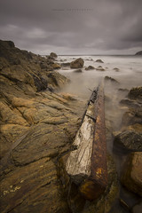 Debris (Schlingshot Photography) Tags: ocean wood old longexposure sea sky black beach clouds landscape fishing rust rocks iron surf waves photographer timber rustic driftwood shipwreck southernocean swell fisheries tonykemp schlingshot