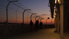 Eiffel Sunset (explored) (chrisroach) Tags: city sunset red sky sun paris france tourism silhouette fence landscape golden dusk eiffeltower landmark tourist parisfrance cityoflight