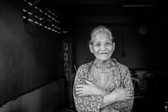 Siem Reap Market Trader (Derek Robison) Tags: cambodia siemreap market portrait blackandwhite