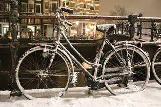 Fresh snow fallen on a Dutch bike