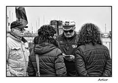 Listen to the Captain (Artico7) Tags: people captain ship guide chioggia sea mediterranian listening listen hat cap italy tourists bw blackwhite blackandwhite biancoenero monochrome fuji xe1